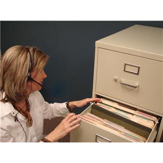 Woman Searching File Cabinet